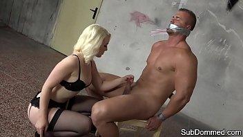 Lingerie Domina Tugging Slaves Cock