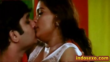 Indian older woman's boobs get licked with honey by young guy