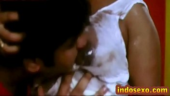 Indian older woman's boobs get licked with honey by young guy image