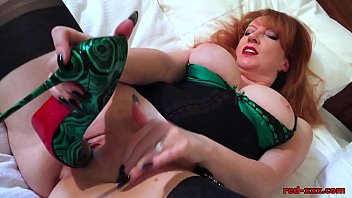 Naughty mature redhead fucks her pussy with her heels video
