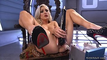 Blonde beauty shoves machine up her ass