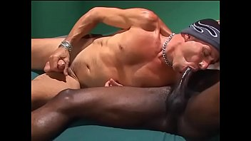 Bisexual threesome with brunette using strapon to fuck with interracial male duo