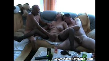 Old granny MILF sucking two cocks at gangbang party