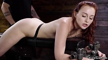 Gagged redhead cunt vibrated in device