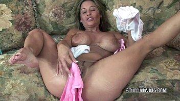 Busty MILF Leeanna Heart is masturbating with her panties