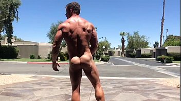 Hot Muscled Stud Flex And JO In Public