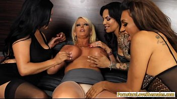 Huge boobs blonde whore Alura enjoyed by three shemales