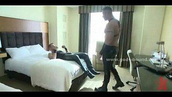 Leather dressed gay spanking sex slave