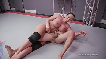 Alura Jenson dominates in mixed nude wrestling kicking loser in the balls