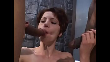 Young brunette with short hair and perky tits Capri likes to suck huge black pole and ride another at the same time