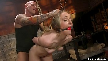 Gagged  blonde fucked in brutal bondage