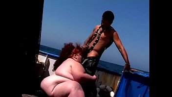Fat lifeguard redhead babe Zazie gets pounded by a fit stud on board a ship