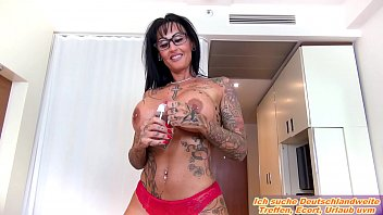 German milf with big tits and tattoo fucks in oil and glasses POV