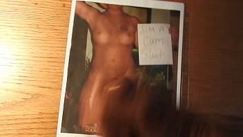 A naked daddy masturbating and cumming on a hot chick'_s picture.