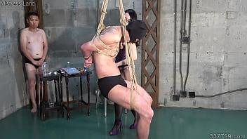 Japanese dominatrix Hitomi makes blowjob between men