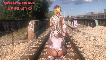 Clown almost gets hit by train while getting head