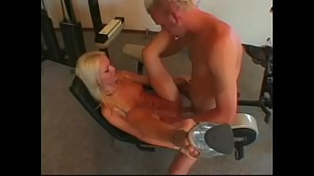 Cute fair-haired flozzie Mandibelle was raken to brown town with really big pecker of fitness instructor on the  cycling machine in the gym