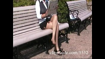 Pantyhose online - Sexy latina secretary shows off her pantyhosed legs in a park