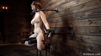 Hot redhead in brutal device bondage
