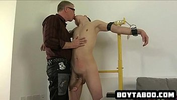 Horny tied up hunk getting his hard cock tugged on