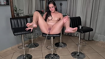 Smoking an pissing while sitting on a bar stool