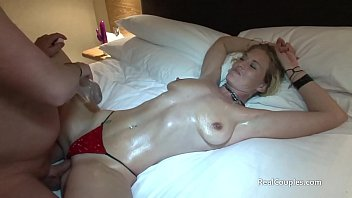 Oiling his wife up before giving her anal