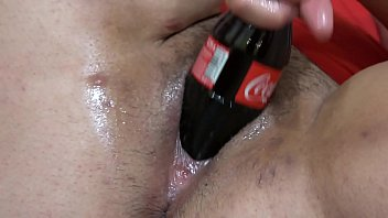 Coca insertion pussy Fat lesbian in a gymnastic pose, and a girlfriend with a big dildo fucks her hairy pussy. and masturbation with a bottle of coca-cola. fetish with a deep, wide hole in a thick cunt.