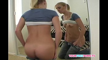 Blonde babe rubbing her pussy in front of the mirror