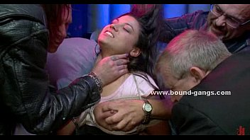 Busty blonde in club undressed tied and forced to perform in brutal gangbang sex