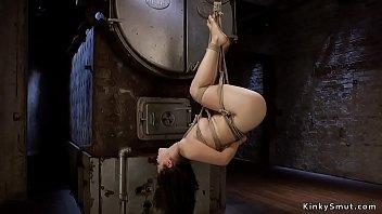 Hogtied Asian in rope suspension upside down