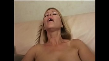 Wild blond MILF with amazing rack Nicole Moore slurps and sucks mutant ebony cock