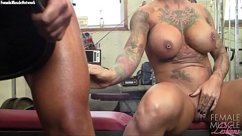 Female bodybuilding porno Two big tit muscle girls play with each other in the gym
