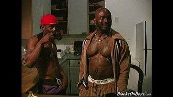 Three black dudes sharing a muscular guy