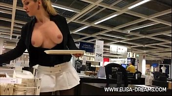 Blonde girl flashing in public shop