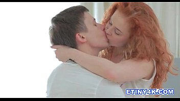 Fiery redhead Entice seduces her man in her thumbnail