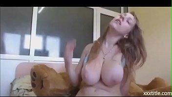 Big tits young woman masturbating at home