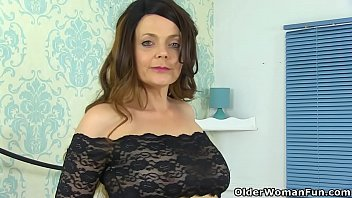 Mature woman dress in sexy outfits British milf gemma gold pleases her hungry cunt with a dildo