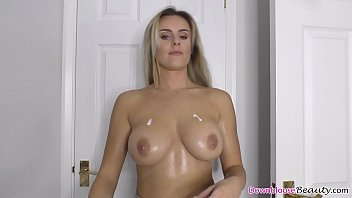 Stunning big boobs blonde babe oiling up her perfect tits image