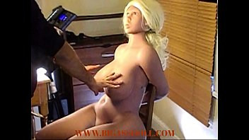 Touching massive  blonde sex doll breast