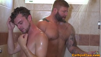 Rimmed twink rides bear cock during shower