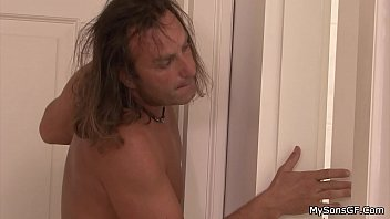 Long-haired old man handling son'_s brunette gf