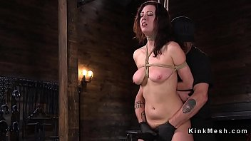 Busty redhead suffers hogtie suspension