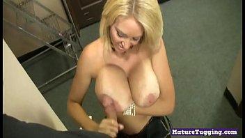 Classy bigtits milf wanking dick on her knees