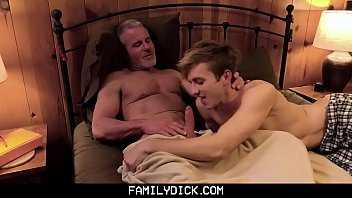 Grandpa and boy on bed