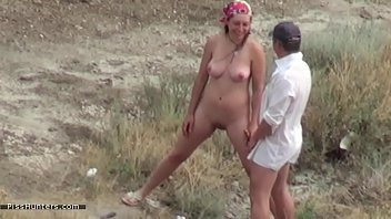 Couple voyeured peeing on nude beach