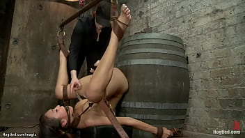 Bound butt plugged Asian on a barrel