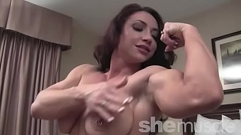 Naked female bodybuilder BrandiMae posing in the bedroom