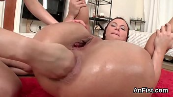 Sexy lesbo honeys are opening up and fist fucking assholes