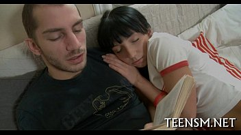 Legal age teenager unbuttons her lover's jeans