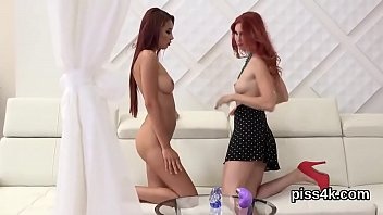 Lovesome lesbian sweeties get splashed with pee and squirt wet slits